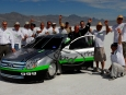 Wendover, UT., Bonneville Speed Week, August 11-17, 2007--A team of Ford Motor Company [NYSE: F] engineers celebrate with the Ford Fusion Hydrogen 999 after the car reached 184 mph today at the Bonneville Salt Flats in Wendover, Utah.  The Ford Fusion Hydrogen 999 is the world's first production based hydrogen fuel cell race car.  A team of Ford Motor Company engineers designed and built the car in collaboration with Ballard, Roush and Ohio State University.  The goal of the project is to be the first production type hydrogen fuel cell powered car to reach 200 mph.  Ford researchers also are working with student engineers from Ohio State on its Buckeye Bullet 2, a streamliner type fuel cell-powered racer attempting to best the 314 mph record set by the electric Buckeye Bullet in 2004. photo by: Sam VarnHagen/Ford Motor Co.