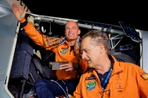 """""""Solar Impulse 2"""", a solar-powered airplane piloted by Bertrant Piccard (left) from Switzerland lands in Ahmedabad in India on Tuesday March 10, 2015, during its historic round-the-world journey finishing the second leg of the journey from Muscat in Oman. With his 15:20 hours flight he set a new world record for solar distance flight with 1486 kilometers. The trip continues on Sunday with Andre Boschberg (right) being the pilot."""