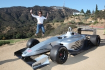 In this image released by Forumla E Holdings, Olivia Moore jumps for her friends in front of the Hollywood sign during a photo shoot for the electric Formula E racing car, Sunday, April 21, 2013, In Los Angeles.  The vehicle is town as part of an announcment naming Los Angeles as one of 10 global cities selected to stage the first electric car racing series beginning in 2014.  (AP Photo/Forumla E Holdings/Rene Macura)