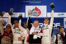 porsche_wins_bahrain_wec_race_l_to_r_romain_dumas__neel_jani___dr_wolfgang_porsche__marc_lieb