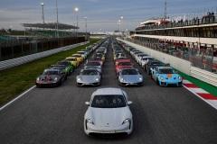 Pietro Innocenti,Direttore Generale di Porsche Italia, a bordo della Taycan (C), prima Porsche 100% elettrica, in occasione della parata che ha visto coinvolte oltre seicento autovetture Porsche durante il Porsche Festival 2019, Misano, 5 ottobre 2019. ANSA/ALESSANDRO DI MEO