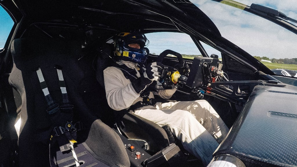 Brabham BT62 with David Brabham Testing on circuit