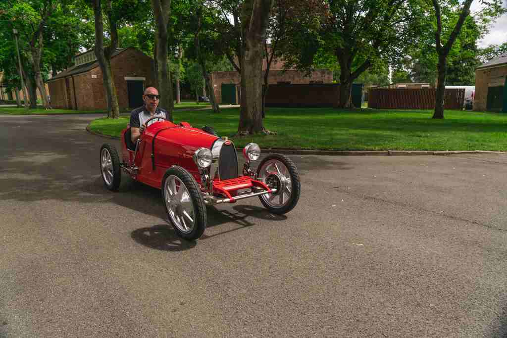 Andy-Wallace-on-his-way-to-the-test-track-at-Bicester-Heritage