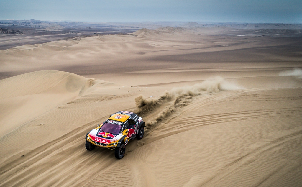 Sebastien Loeb and Daniel Elena in the Peugeot 3008 DKR Maxi of the Team Peugeot Total driving through the dunes during stage 2 of the Dakar Rally, between Pisco and Pisco, Peru, on January 7, 2018.