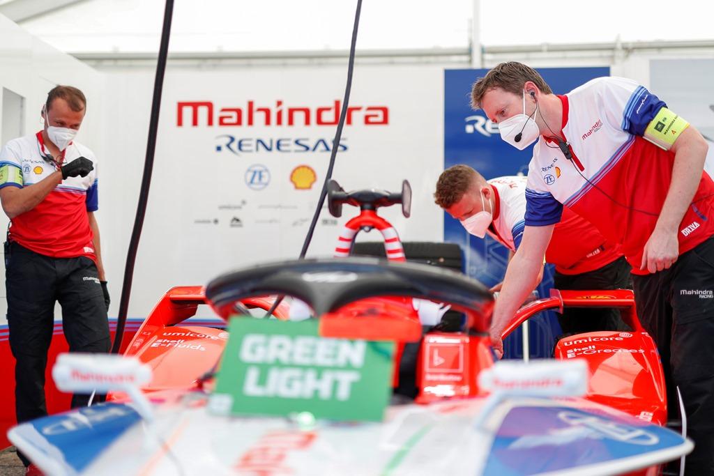 Mahindra Racing mechanics at work in the garage