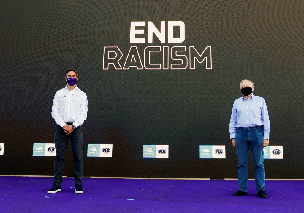 Jean Todt, FIA President and Jamie Reigle, CEO of Formula E in front of end racism signage