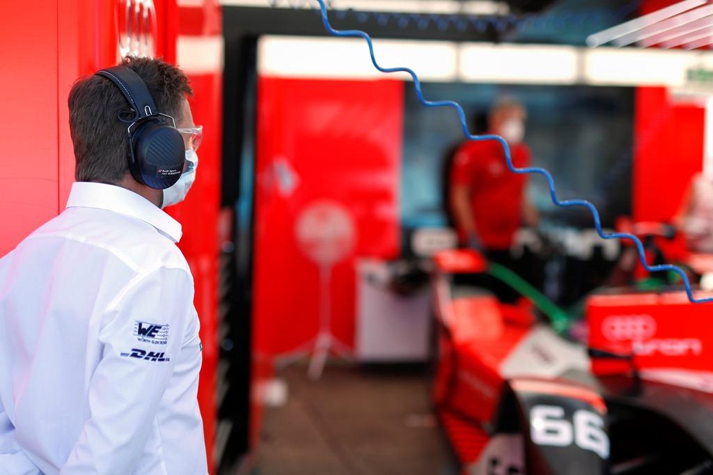 Allan McNish, Team Principal, Audi Sport Abt Schaeffler looks into the garage
