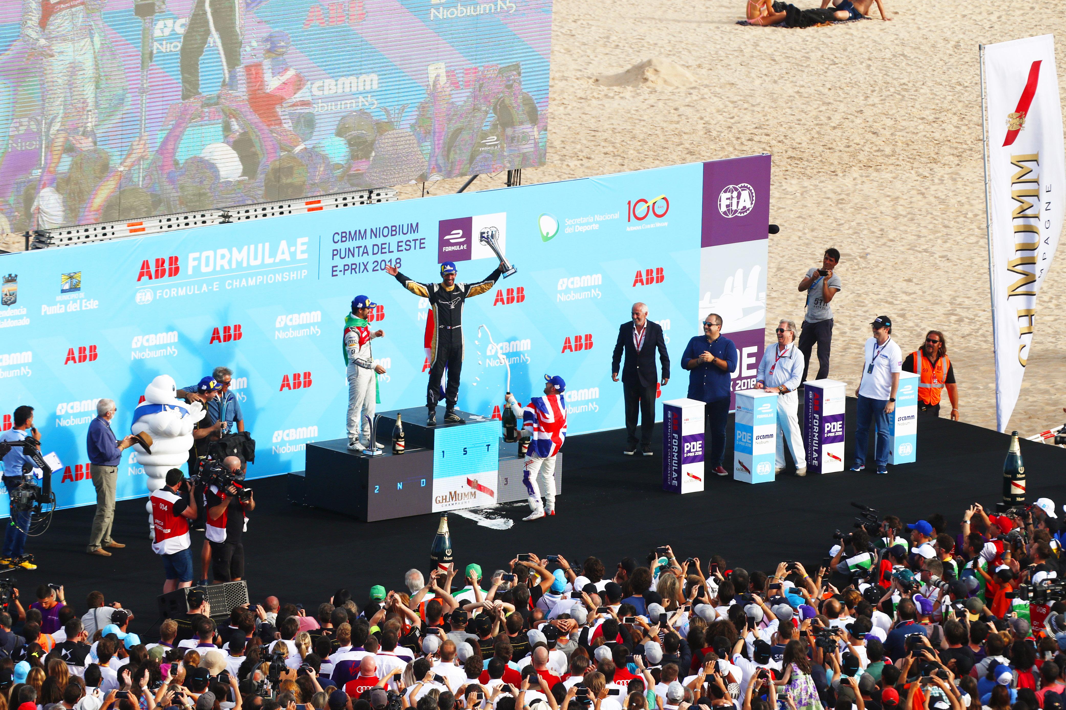 Jean-Eric Vergne (FRA), TECHEETAH, Renault Z.E. 17, Lucas Di Grassi (BRA), Audi Sport ABT Schaeffler, Audi e-tron FE04, and Sam Bird (GBR), DS Virgin Racing, DS Virgin DSV-03, spray the champagne on the podium.