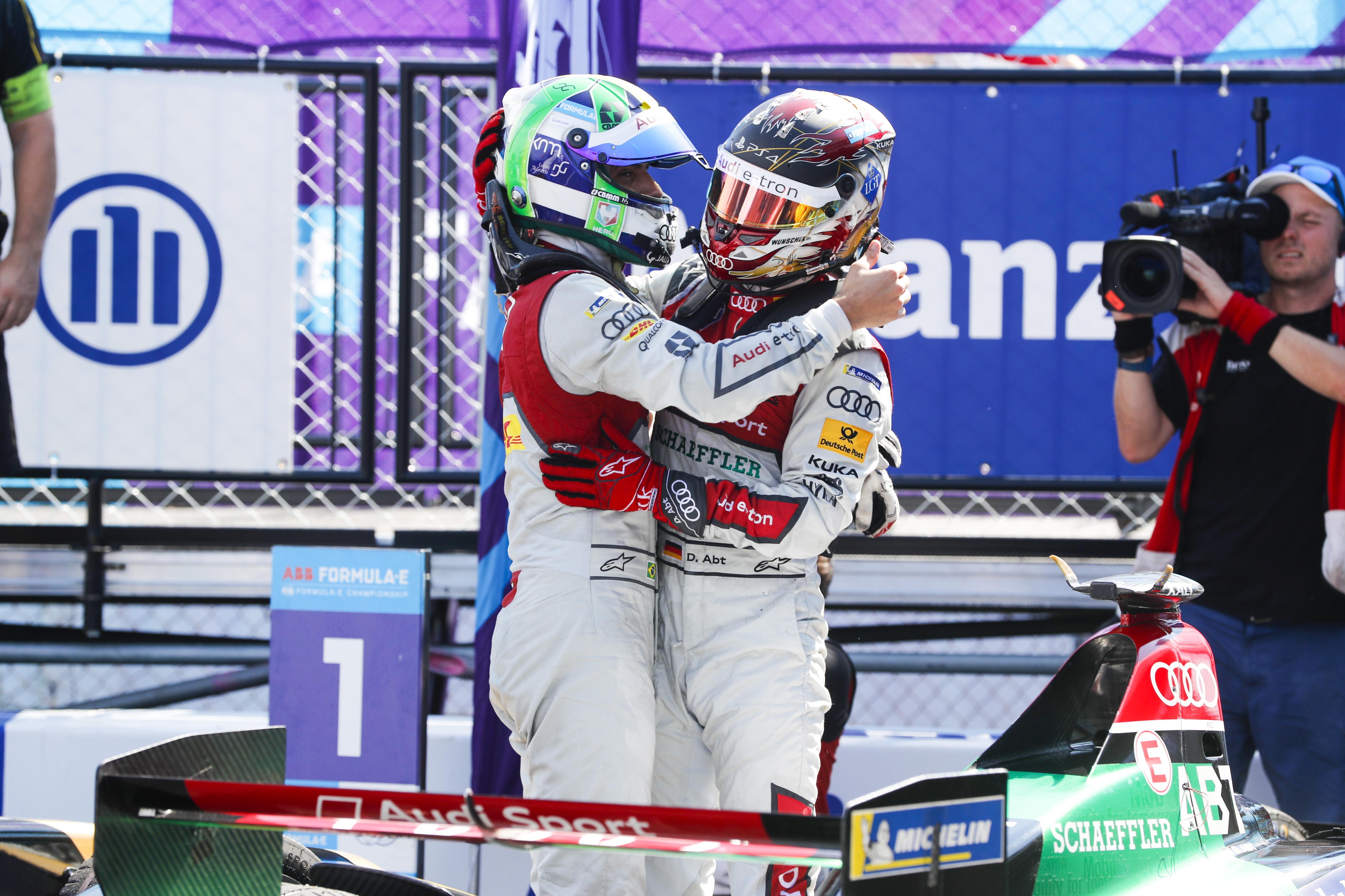 (L-R)_Lucas_di_Grassi_and_Daniel_Abt_embracing_each_other_in_parc_ferme_after_Audi_Sport_ABT_Schaeffler_collect_the_sought_after_teams__title