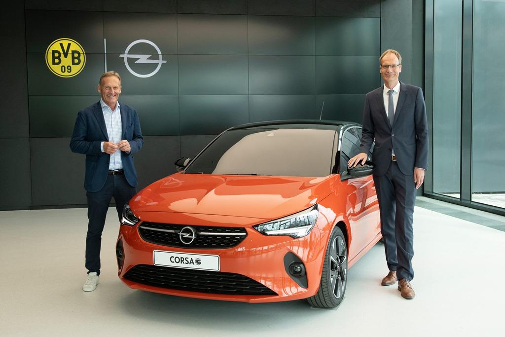 Hans-Joachim-Watzke-Michael-Lohscheller-Opel-Corsa-e-507875
