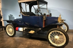 1914-ford-model-t-at-lemay-americas-car-museum-red-can-for-gasoline-blue-for-oil-white-for-water
