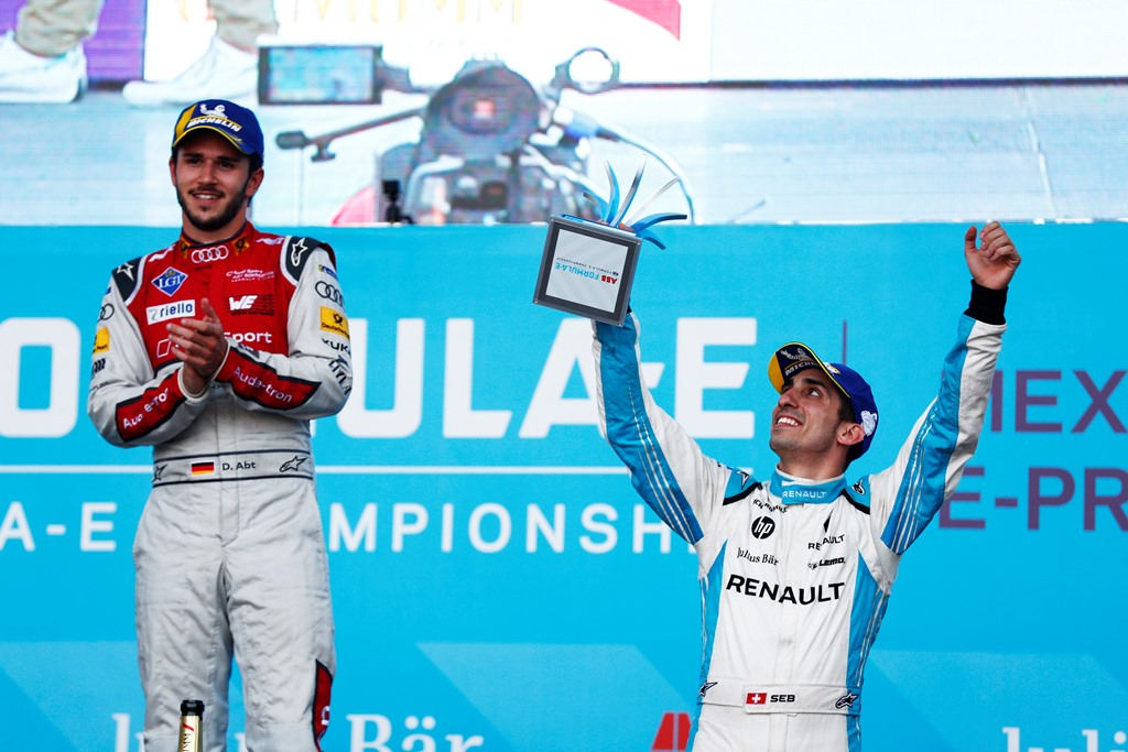 2017/2018 FIA Formula E Championship. Round 5 - Mexico City ePrix. Autodromo Hermanos Rodriguez, Mexico City, Mexico. Saturday 03 March 2018. Daniel Abt (GER), Audi Sport ABT Schaeffler, Audi e-tron FE04, celebrates with Sébastien Buemi (SUI), Renault e.Dams, Renault Z.E 17, on the podim. Photo: Sam Bloxham/LAT/Formula E ref: Digital Image _W6I3642