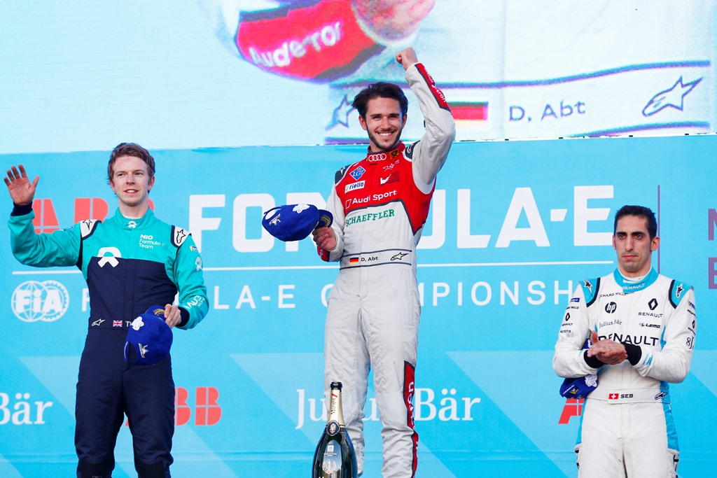 2017/2018 FIA Formula E Championship. Round 5 - Mexico City ePrix. Autodromo Hermanos Rodriguez, Mexico City, Mexico. Saturday 03 March 2018. Daniel Abt (GER), Audi Sport ABT Schaeffler, Audi e-tron FE04, celebrates on the podium with Oliver Turvey (GBR), NIO Formula E Team, NextEV NIO Sport 003, and Sébastien Buemi (SUI), Renault e.Dams, Renault Z.E 17. Photo: Sam Bloxham/LAT/Formula E ref: Digital Image _W6I3625