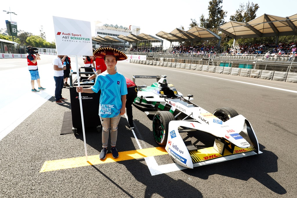 2017/2018 FIA Formula E Championship. Round 5 - Mexico City ePrix. Autodromo Hermanos Rodriguez, Mexico City, Mexico. Saturday 03 March 2018. Grid kid with the car of Lucas Di Grassi (BRA), Audi Sport ABT Schaeffler, Audi e-tron FE04. Photo: Sam Bloxham/LAT/Formula E ref: Digital Image _W6I3116