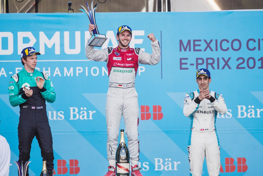 2017/2018 FIA Formula E Championship. Round 5 - Mexico City ePrix. Autodromo Hermanos Rodriguez, Mexico City, Mexico. Saturday 3 March 2018. Daniel Abt (GER), Audi Sport ABT Schaeffler, Audi e-tron FE04, celebrates on the podium after winning the race with Oliver Turvey (GBR), NIO Formula E Team, NextEV NIO Sport 003, and Sébastien Buemi (SUI), Renault e.Dams, Renault Z.E 17. Photo: Zak Mauger/LAT/Formula E ref: Digital Image _54I8964