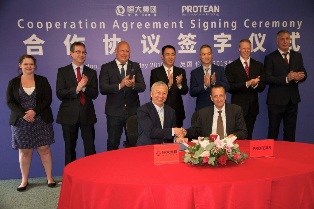Signing-with-Nick-Rich-Protean-Electric-CFO-and-Xu-Jiayin-Hui-Ka-YanEvergrande-Chairman-protean_electric_-in_wheel_motor_expansion_electric_