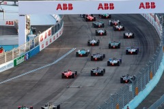 The cars pull away at the start of the race