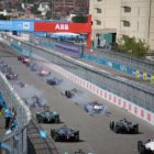 Drivers smoke their tyres at the start of the race